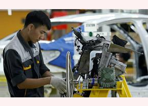 A man works at an assembly line of an auto factory in Hai Phong City, northern Vietnam.