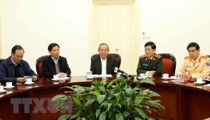 Phó Thủ tướng Thường trực Chính phủ Trương Hòa Bình (giữa) phát biểu.