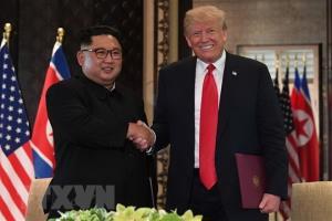 Tổng thống Mỹ Donald Trump (phải) và nhà lãnh đạo Triều Tiên Kim Jong-un tại hội nghị thượng đỉnh ở Singapore ngày 12/6/2018.