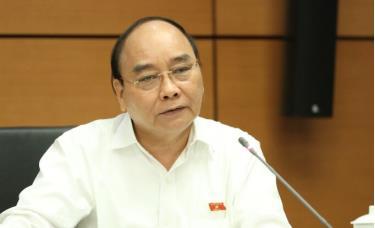 Chủ tịch nước Nguyễn Xuân Phúc phát biểu thảo luận tại tổ ở Quốc hội, sáng 21/10.