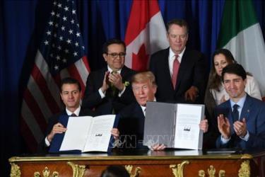 Tổng thống Mexico Enrique Pena Nieto, Tổng thống Mỹ Donald Trump và Thủ tướng Canada Justin Trudeau tại lễ ký Thỏa thuận thương mại tự do Mỹ - Mexico - Canada (USMCA) tại Buenos Aires (Argentina) ngày 30/11/2018.