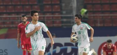 Mohammed Nassif (số 9) mang 1 điểm đầy kịch tính về cho U23 Iraq.