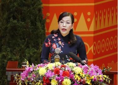 Đồng chí Nguyễn Thanh Hải, Ủy viên Đoàn Thư ký Đại hội đọc danh sách các chính Đảng, tổ chức và bạn bè quốc tế gửi thư, điện chúc mừng Đại hội XIII của Đảng.