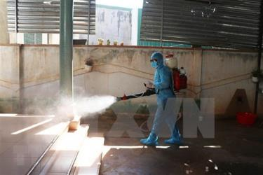 Spraying disinfectant at an exercise on responding to a COVID-19 outbreak .