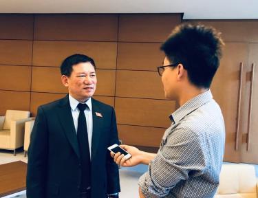 Tổng Kiểm toán Nhà nước Hồ Đức Phớc trả lời phỏng vấn báo chí.