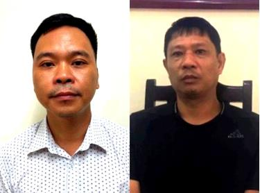 Các bị can Võ Việt Hùng (bên trái) và Bùi Quốc Việt (phải).