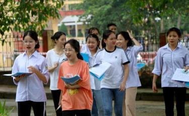 Examinees leave a test venue at the province's boarding high school for ethnic students after completing the test on natural sciences/social sciences.