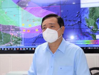 Ông Trần Quang Hoài trả lời câu hỏi của báo giới về ứng phó cơn bão Conson khi có hơn 4.000 ca F0 ở khu vực cần sơ tán