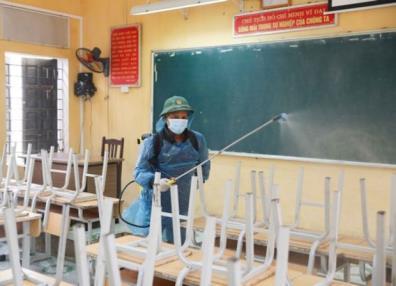 A classroom in Hanoi is sterilised.