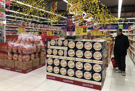 Supermarkets and shops prepare goods to serve locals